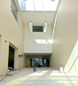 October 11, 2013 - The atrium is being tiled. In this photo, we are looking from the new main entrance towards the back. The window below the skylight is in a new meeting room or office.
