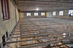 February -, 2013 - All that's left of the middle floor are the steel beams, which will be lowered once cement footings are built