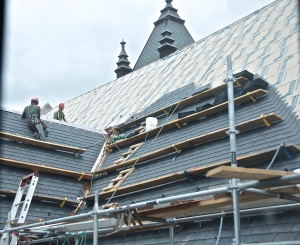 August 13, 2013 - Shingles being applied to the sanctuary roof