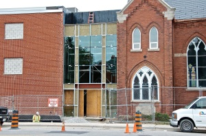 September 13, 2013 - Windows at the main entrance are being installed