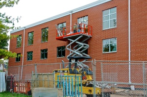 September 13, 2013 - The glass being installed in the windows on the west side of the community building