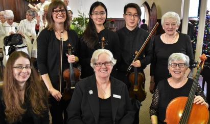 Instrumental Ensemble: left to right, back row; Bethany Middleton (violin), June Kim (violin) and Yun-Kyo Kim (violin), Dawn Brodie (piano). Front row Liv Schachter (flute), Myra Hudspeth (clarinet), Judy Hunter (cello).